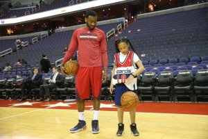 Amaris Jackson, a 10 year-old who signed a one day contract with the Washington Wizards (via Make A Wish), with John Wall. Credit; Monumental Network